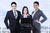 Business team with laptop on business presentation — Stock Photo