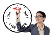 Businesswoman drawing annual clock — Stockfoto