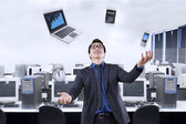 Businessperson juggling with business items — Stock Photo