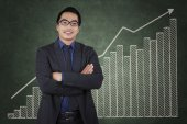 Confident entrepreneur with business growth chart — Stock Photo