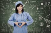 Surgeon student makes heart symbol — Stock Photo