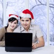Couple using laptop in winter day — Stock Photo #57037965