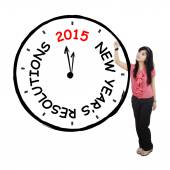 Female worker makes resolution clock — Stock Photo