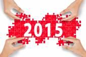 Hands arrange number 2015 — Foto de Stock