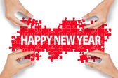 Hands make new year text — Stock Photo