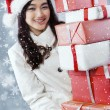 Beautiful girl carrying many presents — Stock Photo #58036329