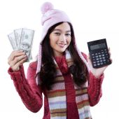 Girl with calculator and money dollars — Stock Photo