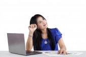 Female worker daydreaming while working — Stock Photo