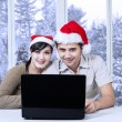 Couple using laptop for browsing internet — Stock Photo #58168101
