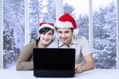 Couple using laptop for browsing internet — Stock Photo
