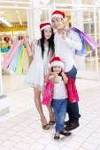 Family with shopping bags at mall — Stock Photo