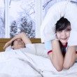 Woman and snoring man on bed — Stock Photo #58170443