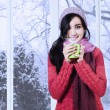 Young lady wearing sweater enjoy warm drink — Stock Photo #58170879