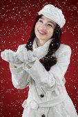 Cute woman catching snowfall — Stock Photo
