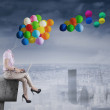 Businesswoman with balloon head on rooftop — Stock Photo #59245971