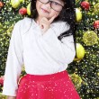 Cute little girl with christmas tree — Stock Photo #59246345