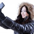 Girl in winter clothes taking self photo — Stock Photo #59246777