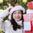 Joyful girl holding christmas presents — Stock Photo #59247347