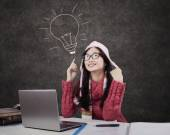 Female student in winter clothes in class — Foto Stock