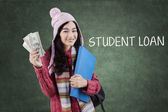 Schoolgirl with warm clothes and money — Stock Photo