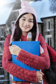 Sweet student standing near the school — Stock Photo
