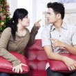 Couple quarreling on sofa in christmas day — Stock Photo #59920653