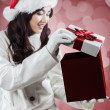 Girl opening a christmas gift — Stock Photo #59922711
