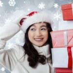 Hispanic girl holding presents boxes — Stock Photo #59923403