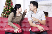 Couple quarreling on sofa in christmas day — Stock Photo