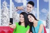 Cheerful people take self photo at home — Stock Photo