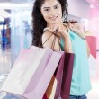 Attractive indian girl with shopping bags — Stock Photo #60219321