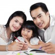 Cheerful family doing schoolwork together — Stock Photo #60219989