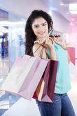 Attractive indian girl with shopping bags — Stock fotografie