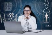 Pretty indian doctor with medical background — Stock Photo