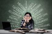 Schoolgirl having problems when studying — Stock Photo