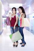Two asian people with shopping bags — Stock Photo