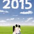 Family looking at numbers 2015 on the sky — Stock Photo #61485655
