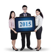 Businessteam holding number 2015 — Stock Photo