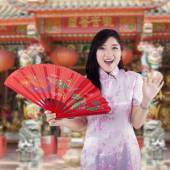 Chinese woman with traditional cheongsam dress — Stock Photo