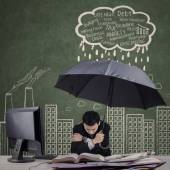 Cold worker using an umbrella — Stock Photo