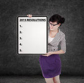 Female manager with resolution board — Stock Photo