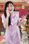 Girl in cheongsam dress screaming in the temple — Stock Photo