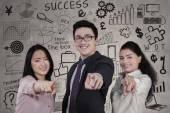 Multiracial entrepreneurs with scribbles — Stock Photo