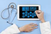 General doctor hands using tablet — Stock Photo