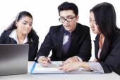 Business group discussing a document — Stock Photo