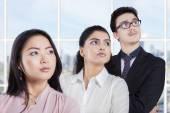 Confident entrepreneurs standing in a row — Stock Photo