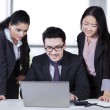 Multiracial entrepreneurs using laptop — Stock Photo #62512843