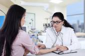 Female patient checked by doctor — Stock Photo