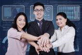 Multicultural businesspeople joined hands — Stock Photo