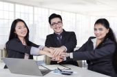 Multiracial business team showing unity — Stock Photo